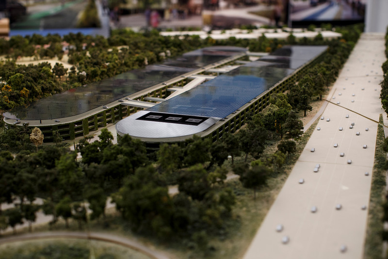 A rendering of Apple's proposed new campus includes parking structures by Interstate 280.