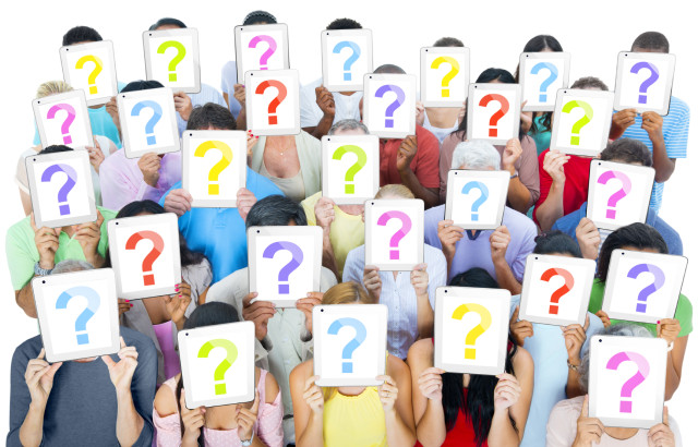 Multi-ethnic group of people holding the talet's question mask screen