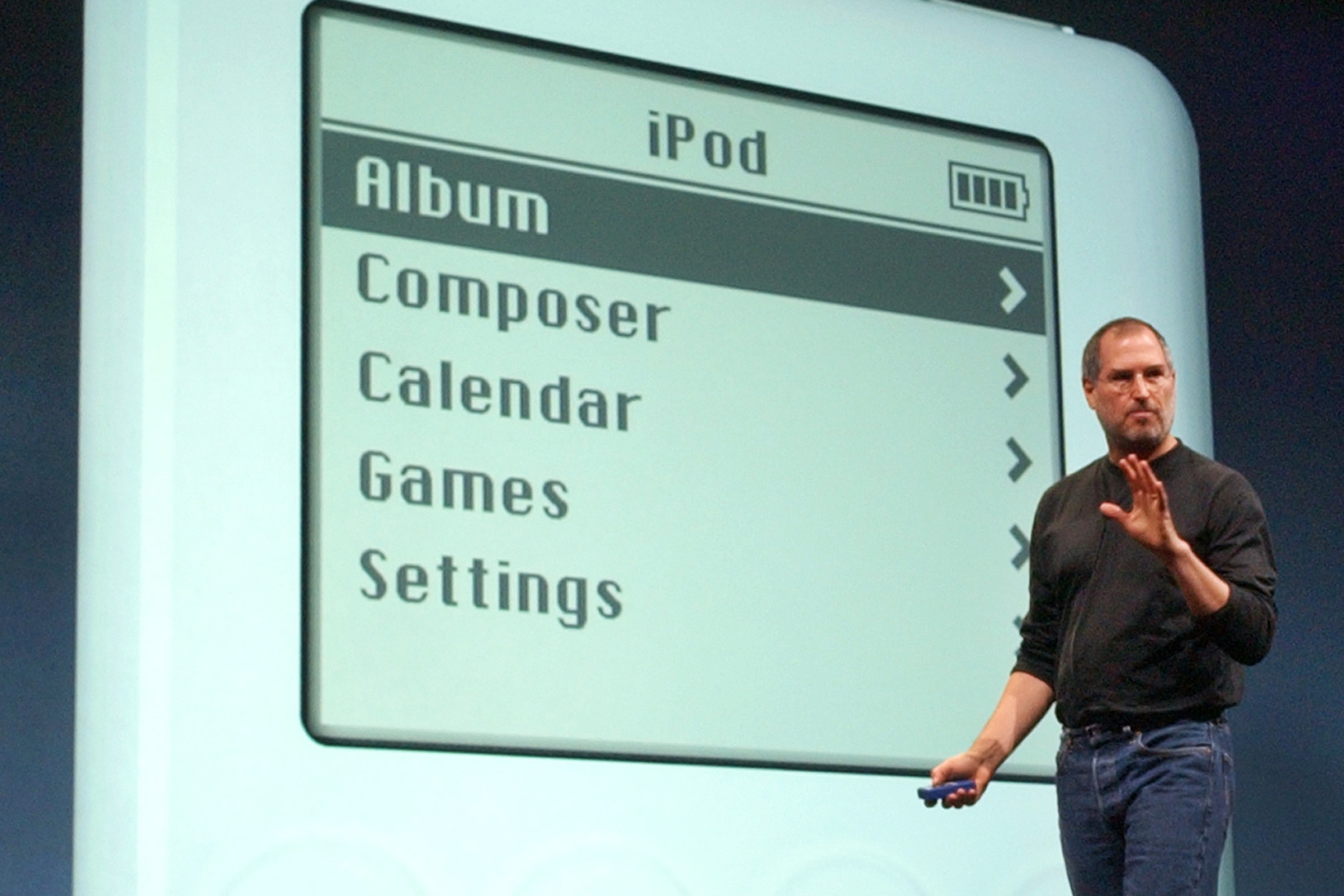 "Apple Computer Inc. chief executive Steve Jobs gestures as he introduces the new iPod during Apple's launch of their new online ""Music Store"" in San Francisco, Monday, April 28, 2003. (AP Photo)"