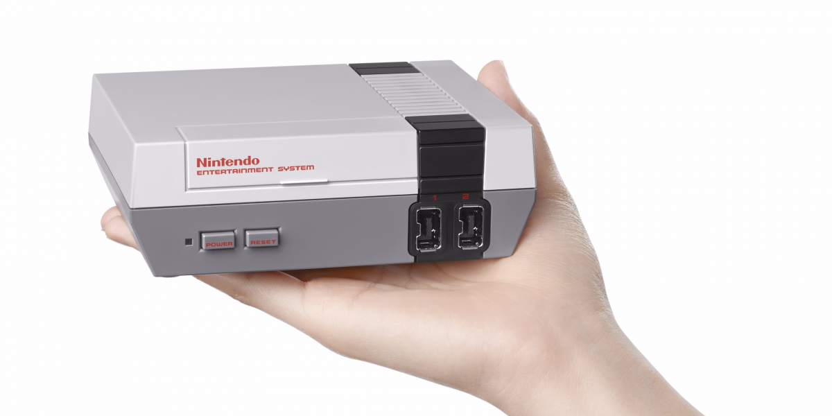 this-is-the-nes-classic-edition-as-you-can-see-its-quite-small-it-can-fit-in-the-palm-of-your-hand-and-it-will-fit-nicely-in-any-entertainment-center.jpg