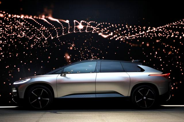 A Faraday Future FF 91 electric car is displayed on stage during an unveiling event at CES in Las Vegas, Nevada January 3, 2017. REUTERS/Steve Marcus