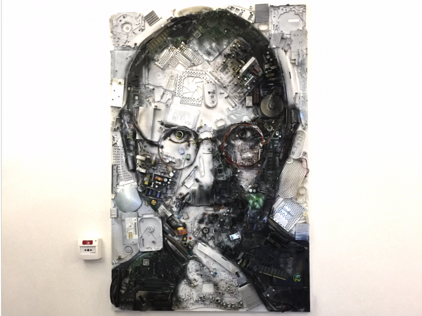 One of the first things you see is a portrait of steve jobs made from the components of six imac g3s a line of apple computers from 1998 2003 jpg