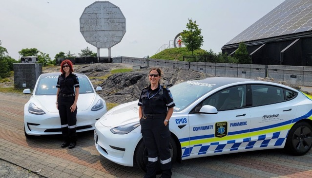Sudbury EMS personnel alongside two of the citys all electric Tesla Model 3s